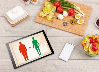 Arrangement of healthy Ingredients with a tablet. Dieting concept