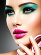 Leinwandbild Motiv Beautiful Face of a woman with green vivid make-up of eyes