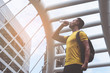 Yellow sporty guy is drinking water in hot day outdoor
