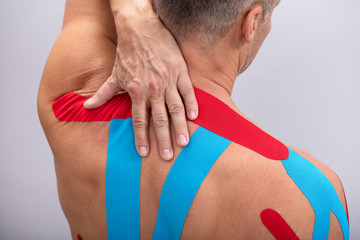 Rear View Of Man With Physio Tape