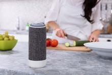 "Постер, картина, фотообои ""Close-up Of Voice Assistant Speaker On Kitchen Counter"""