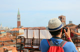 boy photographs the bell tower of San Marco in Venice