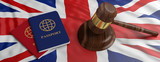 Two passports and a judge gavel on United kingdom flag background. 3d illustration - 246968348