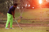 Golfers are playing golf in the evening golf course