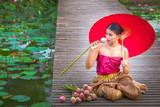 Asian Thai women sitting on a wooden platform in Bua Luang