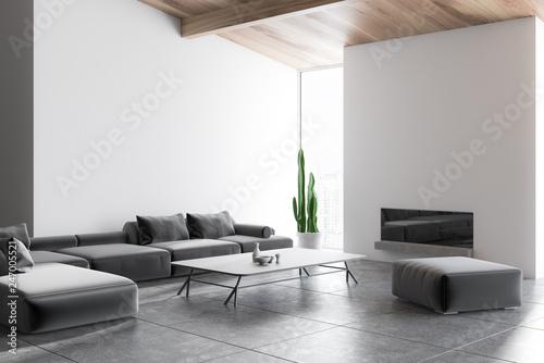 White living room corner, gray sofa