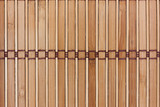 Beige bamboo mat with dark threads. Texture for background and design.
