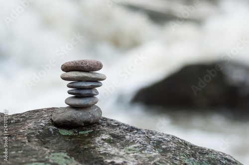 Closeup of stone balance on rock in border river - 247013147
