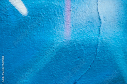 closeup of blue graffiti on the wall texture - 247022120