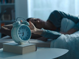 Woman waking up in the morning and alarm clock - 247022992