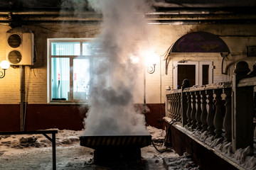 city house heating system. steam come out of grid b © Mihail