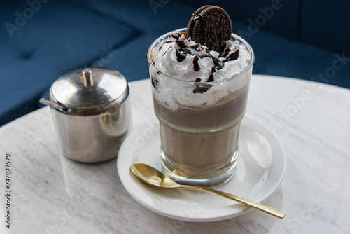 ice cream with chocolate chip cookies in a glass with a straw © Александр Байтельман