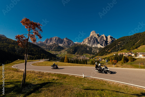 Motorcycle in the autumn on a pass road with blue sky © Michael Schroeder