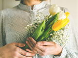 Woman holding bouquet of tulips. Woman's day - 247034767