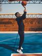 Man shooting basketball on basketball court