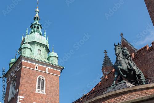 Wawel Royal Castle in Krakow Poland, with Tadeusz Kościuszko Monument in front