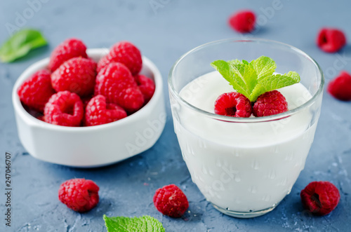 Greek yougurt with fresh raspberries and mint - 247046707