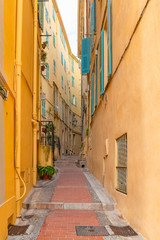 Menton, narrow street in the old town, French Riviera, typical houses