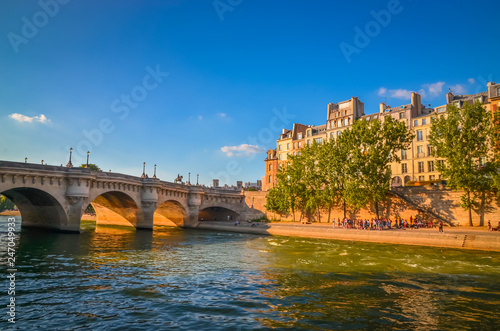 Bridge Pont Neuf and buildings near the Seine river in Paris, France - 247049933