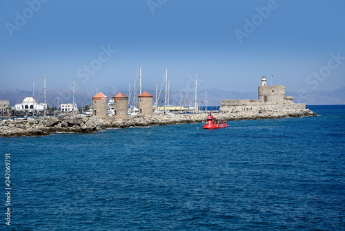 Cruise ships call into the deepwater harbour in Rhodes Greece. Mandraki is the ancient harbour with tour boats