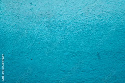 closeup of blue graffiti on the wall texture