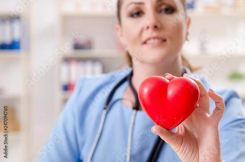 Leinwandbild Motiv Female doctor cardiologist working in the clinic