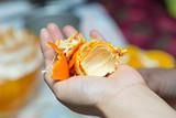 orange peel in hands