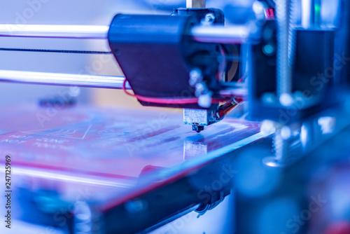 close up photo of futuristic 3d printer. micro and nano electronics b © Mihail