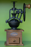 Hand coffee grinder is located on the floor. - 247136915