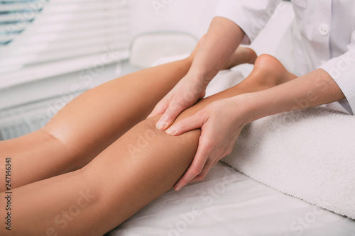 Close-up of feet, woman having leg rehabilitation massage