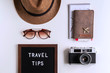 Retro camera with  toy plane, map and passport on white background, Travel tips concept
