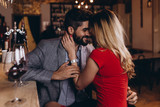 Romantic date in restaurant, young couple at bar counter. - 247163316