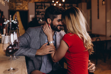 Romantic date in restaurant, young couple at bar counter.