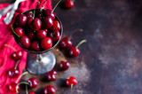 Cherries with drops of dew close up in a vase