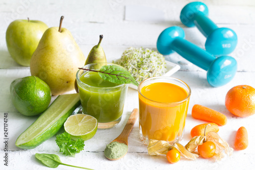 Smoothie fresh fruits dumbell  and young sprouts healthy life style food fitness concept - 247174748