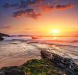 Amazing sunset on the ocean. View of dramatic cloudy sky and stony coast.  Portugal. Concept of the harmony with wildlife, romance, emotional experience in your soul, joy in mundane life.