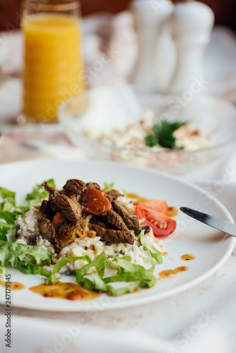 Soup and main dish in the restaurant - 247179345