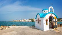 """Постер, картина, фотообои """"Colorful greek orthodox chapel by the sea near Chania in Crete, Greece"""""""