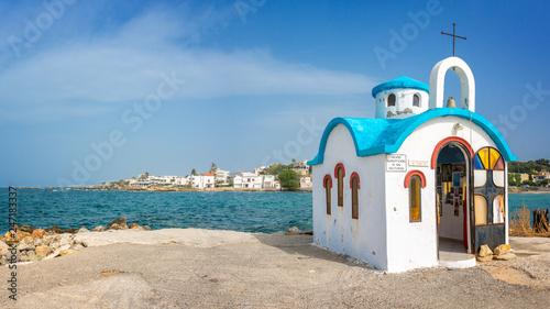 Leinwanddruck Bild Colorful greek orthodox chapel by the sea near Chania in Crete, Greece