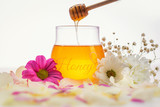 Honey and flowers on a white background