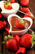 Valentine Chocolate fondue melted with fresh strawberries and dark and white chocolate. Tublips and sugar hearts.