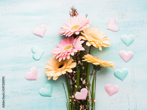 Beautiful flowers and hearts on pastel green