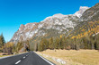 Quadro country asphalt road in dolomites alps at autumn season