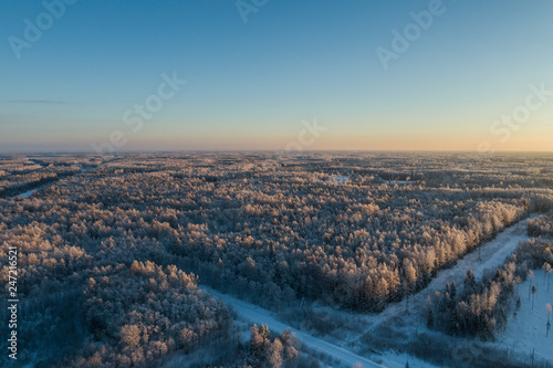 Aerial view of a beautiful sunset in the winter forest.  - 247216521