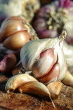 Garlic bulbs on wooden rustic table in panorama shape. A pile of garlic peeled cloves. - 247224164