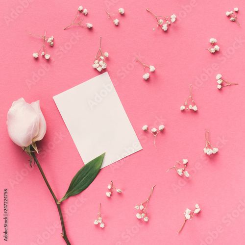 Rose flower with small paper on table - 247224756
