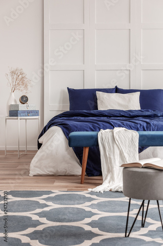Leinwandbild Motiv Simple navy blue and white bedroom interior design