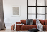 Scandinavian apartment interior with comfortable couch - 247232777