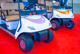Golf car. Electric car Car for the transportation of tourists. Golf car white.