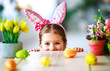 Leinwanddruck Bild - Happy easter! funny child girl with rabbit ears and . eggs  .